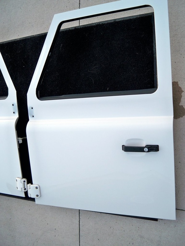 These are New Take Off (NTO) Land Rover Defender 90 / 110 Station Wagon Front Doors for Defenders (1983 - 2011) and Series trucks (1959 - 1983). & Parts - INDIANA OVERLAND LLC